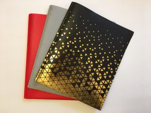 Red, grey and black three pronged folder